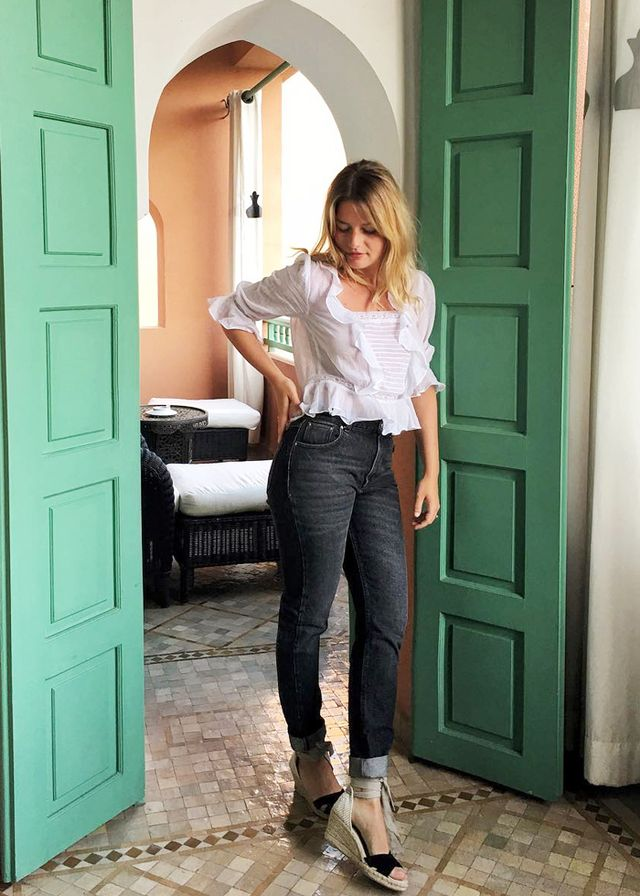 Sabina Socol in espadrilles and white blouse