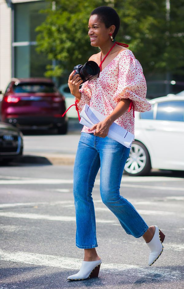 Jeans, a T-shirt, and boots might be the easiest outfit combination. Simply swap in a printed blouse with a bit of dramatic volume instead and voilà! Instantly more impact...
