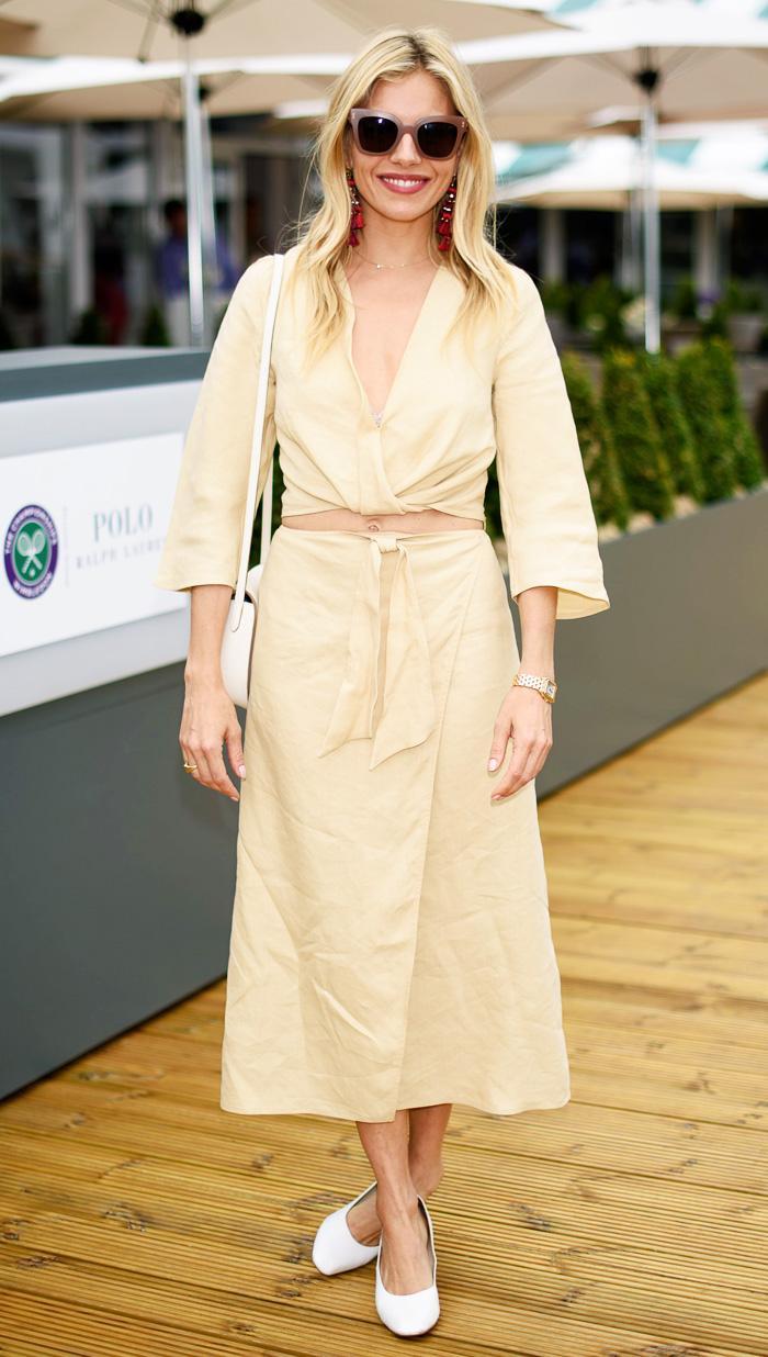 Sienna Miller wearing yellow at Wimbledon
