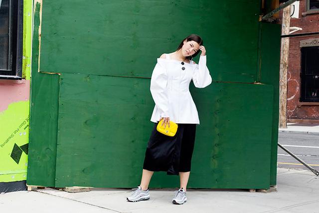 On Rachel Besser: Acne Studios Palm Satin Wrap Pencil Skirt ($264); Ellery Sugar Off The Shoulder Top ($918); Alexander Wang Cross Earrings ($295); Nike Air Max '97 Sneakers ($339); Chanel bag.