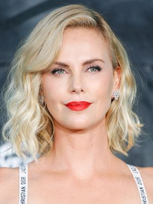 Charlize Theron Wears Only a Bra on the Red Carpet, Looks Stunning