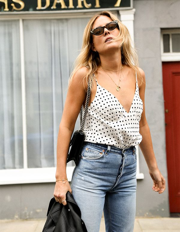 A light and silky camisole is an easy way to add the whimsical print to an outfit. Just add jeans and a leather moto jacket like Lucy Williams's.