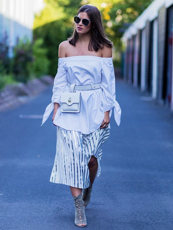 White-on-white layering makes the fanny pack a chic addition to the ensemble.