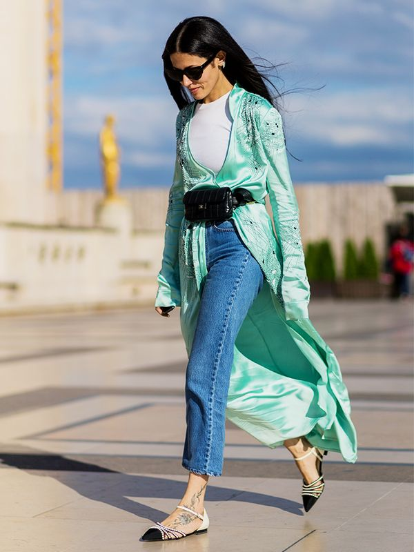 Sub in a fanny pack as a high-waisted belt with a long duster coat.
