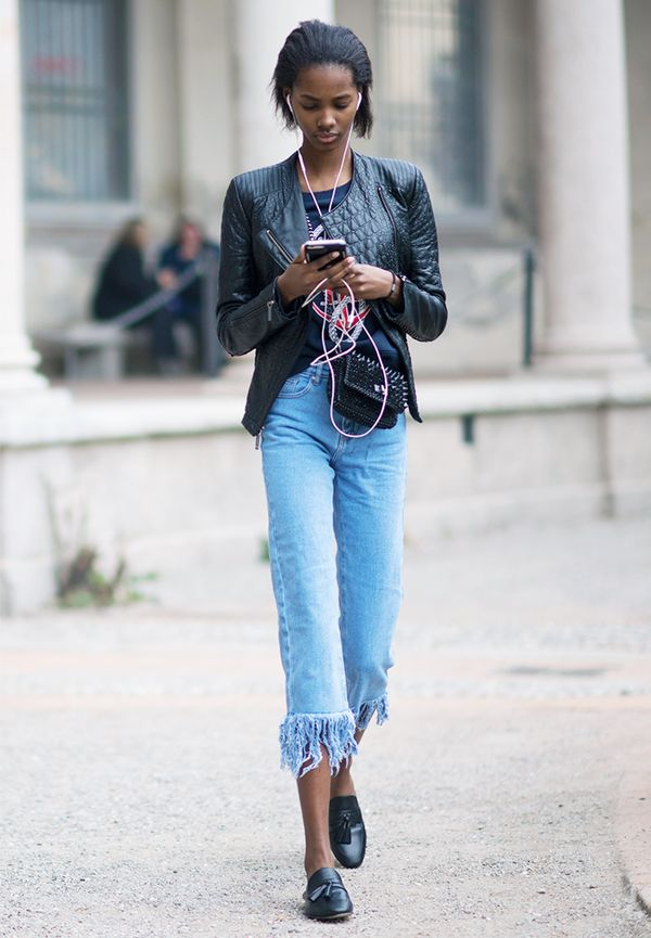 For something a bit more subtle, a small black fanny pack worn slightly to the side is an effortless way to go hands-free in jeans and a leather jacket.