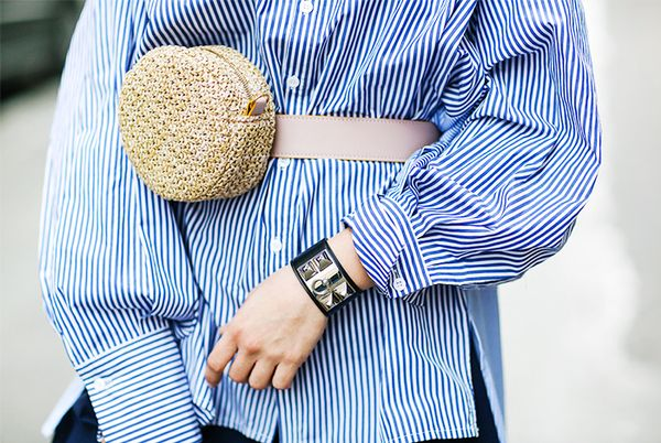 Combine two trends into one with a straw bag iteration of the fanny pack.