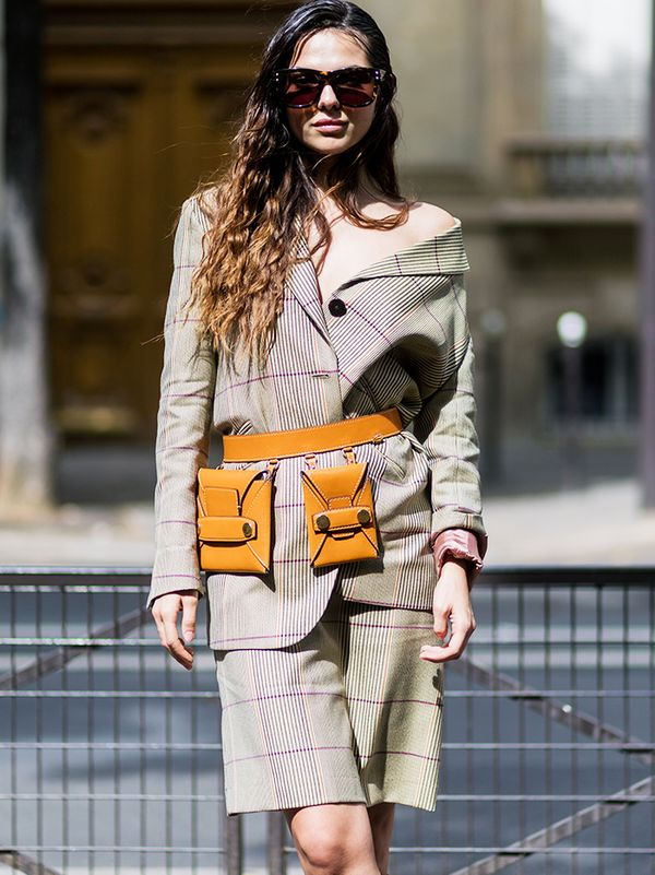 Who knew a fanny pack could look so sophisticated and chic? Take an elevated approach with a natural leather iteration paired with classic plaid.