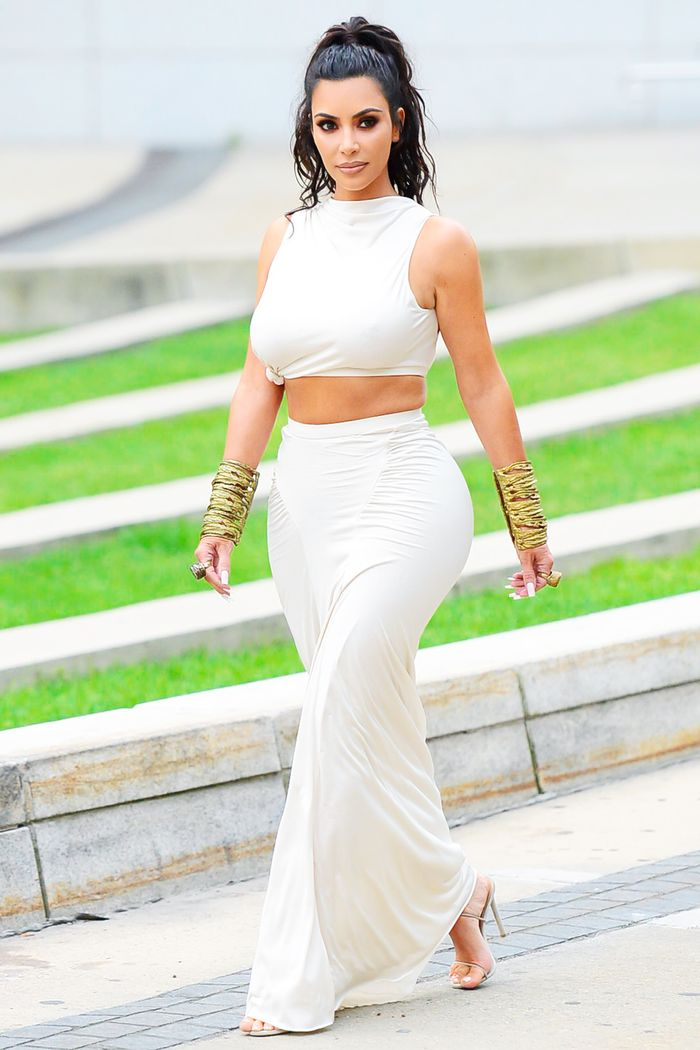 Best clothes for big bums: Kim Kardashian wearing white midi skirt and crop top