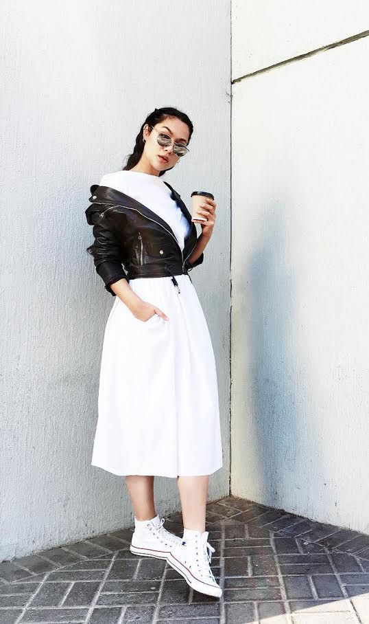 A full skirt instantly helps add volume to the bottom half of a woman's body. But it's this minimally zippered, off-the-shoulder leather jacket styling that completes the hourglass,...