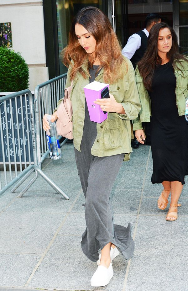 A maxi dress also proves to be a cool complement to the army jacket, as demonstrated by Jessica Alba.