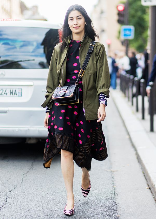 Don't be afraid to pair your army jacket with dressier ensembles like a festive dress and heels.