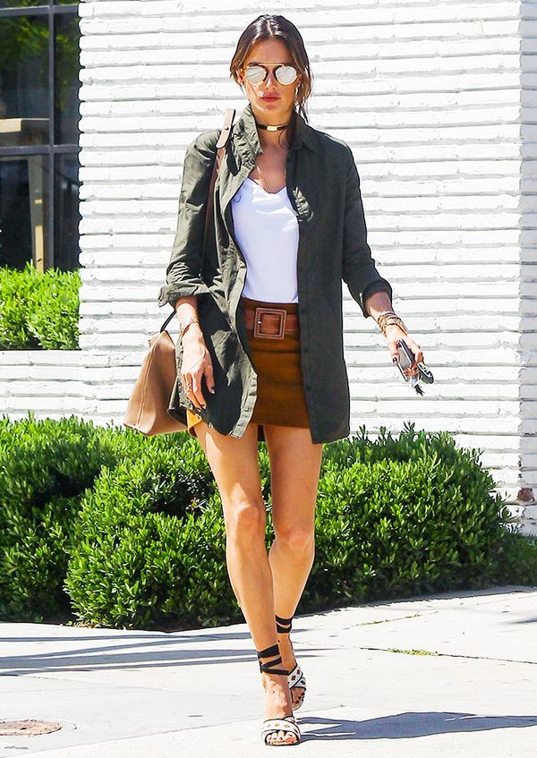 An army jacket over a skirt of a similar length works surprisingly well, especially when pared back with a simple T-shirt, as Alessandra Ambrosio styles here.