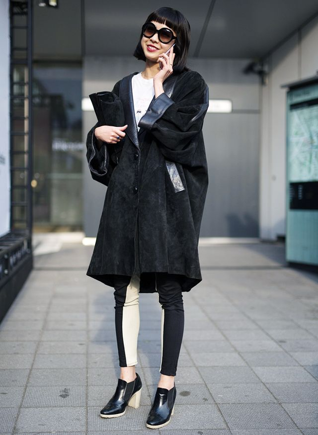 When the outfit takes a more subdued approach to color, interest is created by playing with proportions and incorporating unexpected textures. This oversize and intentionally ill-fitted suede coat...