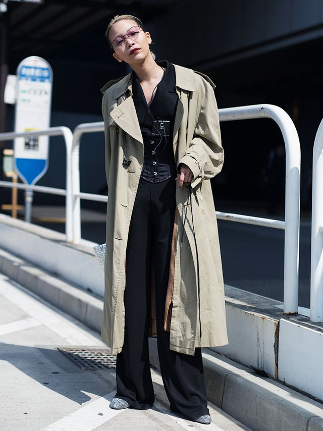 This ensemble exhibits the oversize bottoms trend and plays with proportions. Wide-leg pants (worn extra long) and a blazer are unexpectedly cinched in at the waist with a matching black corset...