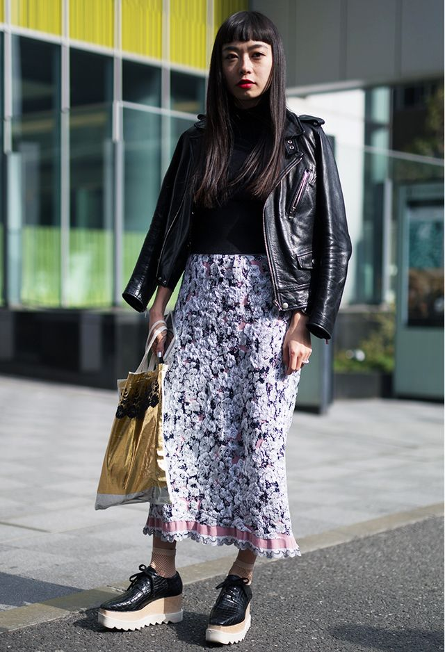 The jacquard effect of this maxi skirt adds a feminine touch to the otherwise all-black ensemble, while a leather biker jacket and black leather platform brogues add an edgy vibe.