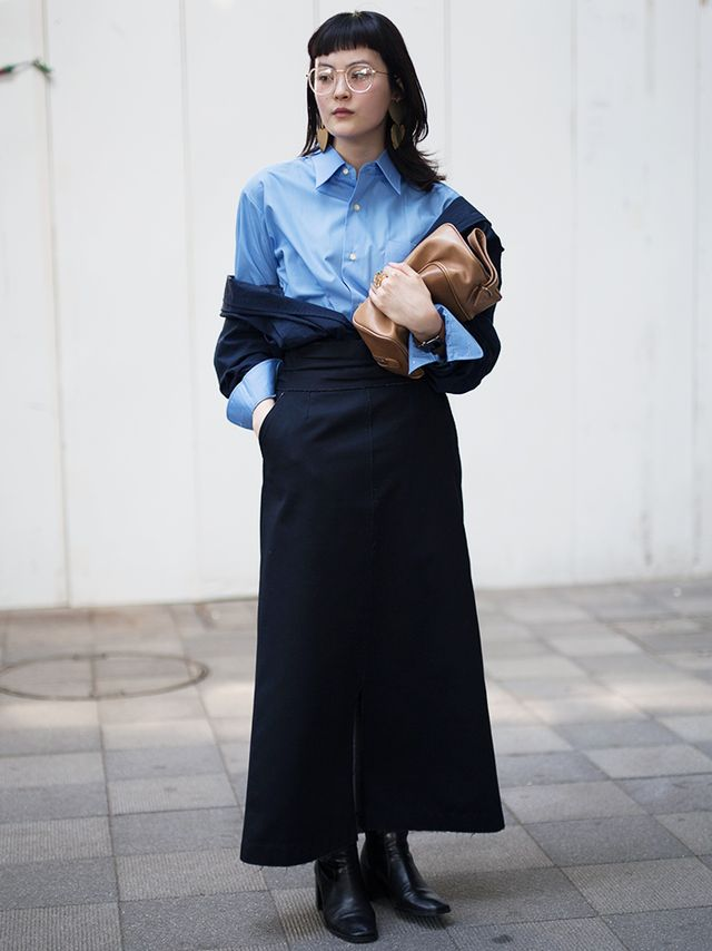 This maxi skirt and button-down pairing is made inimitably chic with an off-the-shoulder jacket, and black leather ankle boots pare down the entire ensemble. Next up, discover the fail-safe...