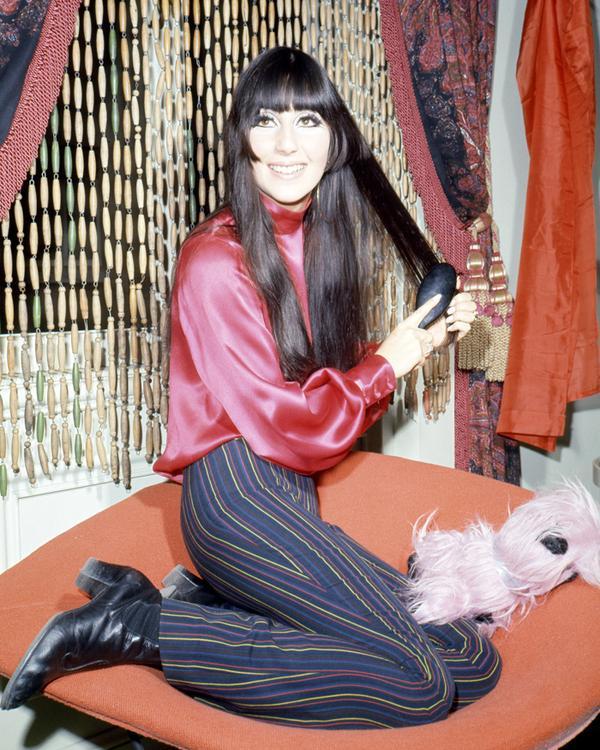 Cher brushing hair in 1968