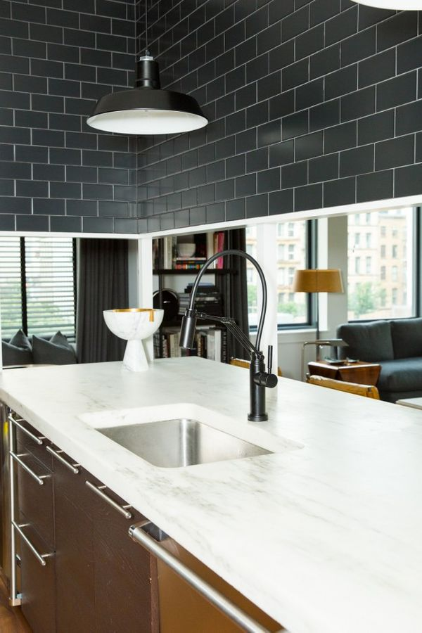 Who knew edgy subway tiles and a delicate marble countertop could complement each other so well?