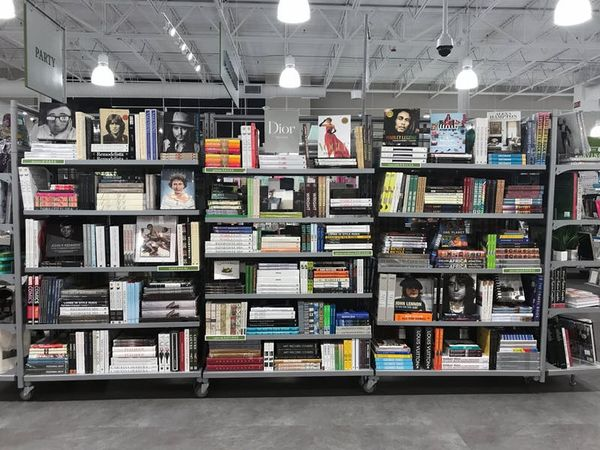 Massive shelving units are dedicated to coffee table books, décor accents, and other knickknacks.