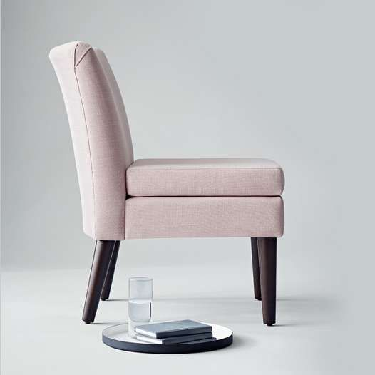 """The armless Slipper Chair, $130, was designed to """"squeeze in practically anywhere."""""""