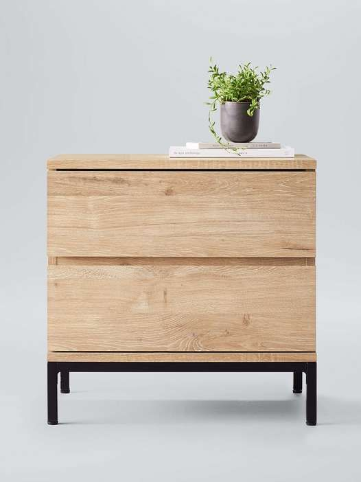 Keep things light in the bedroom with the line's budget-friendly nightstands.