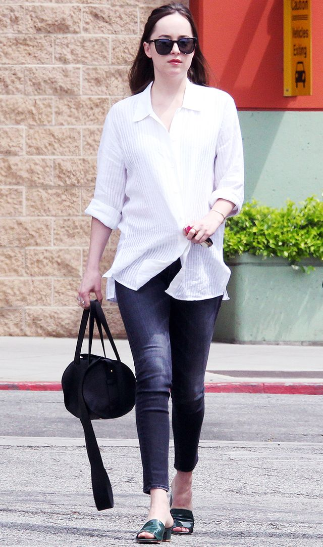 Dakota Johnson in heeled slides