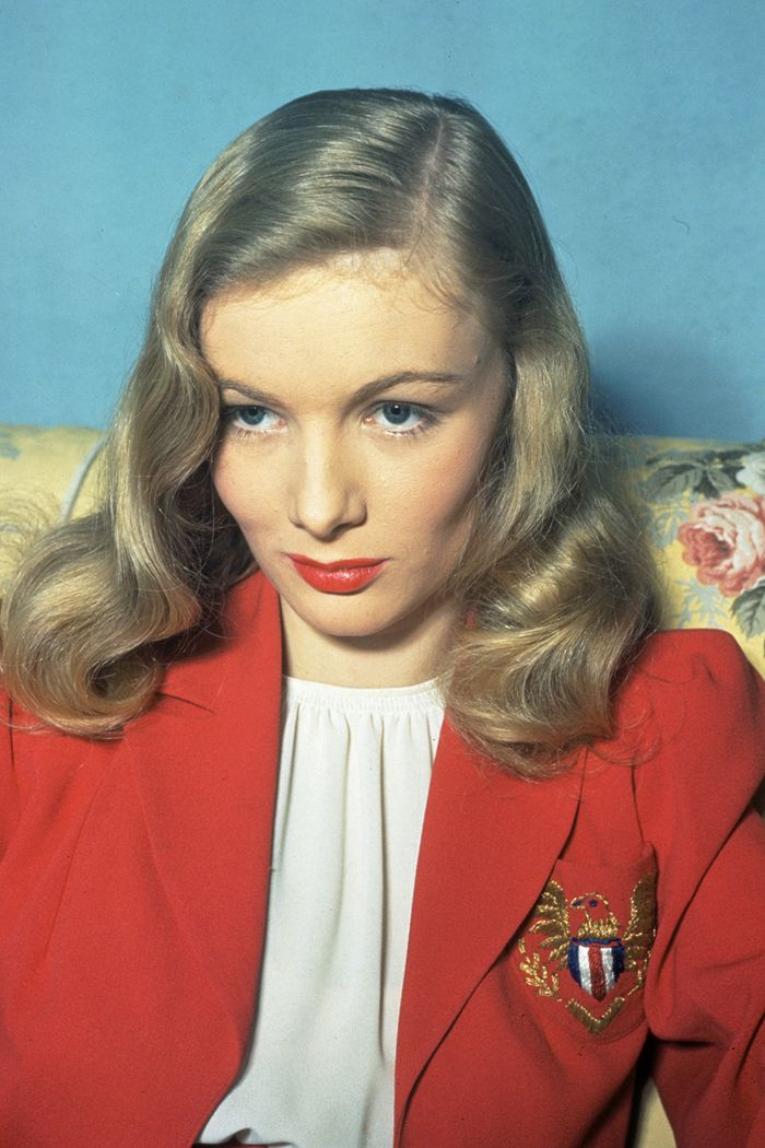 1940s fashion: Veronica Lake wearing  a red blazer and white blouse