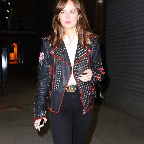 gucci belt: Dakota Johnson in New York City wearing studded, floral leather jacket and belt from Gucci