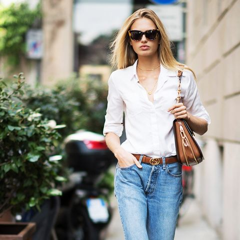 gucci belt: Romee Strijd is wearing blue jeans a belt from Gucci and a Michael Kors bag seen during Milan Fashion Week