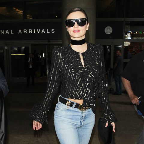 gucci belt: Miranda Kerr wearing Gucci belt and skinny jeans
