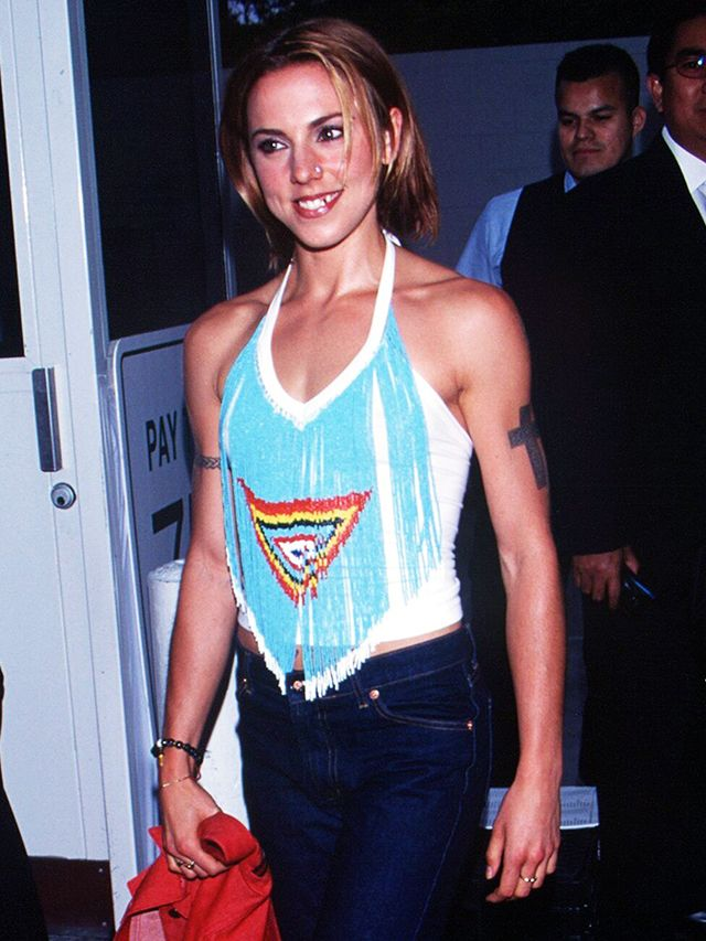 90s fashion: Mel C wearing a beaded halterneck top