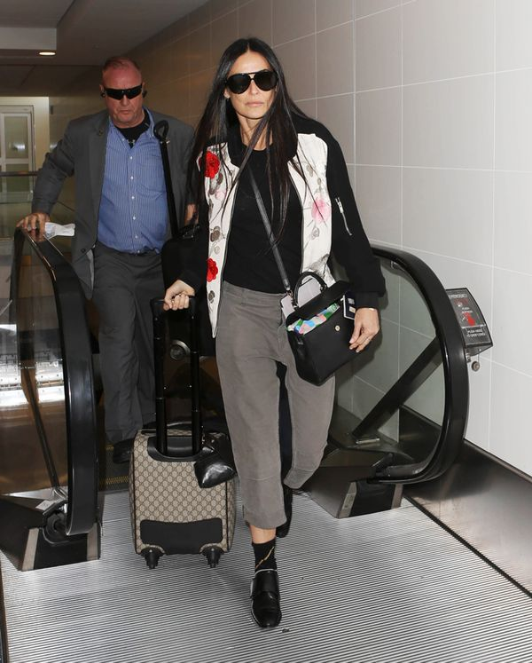 Demi Moore carries Gucci.