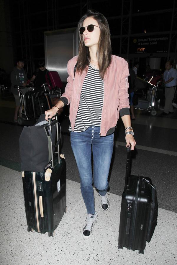 Alessandra Ambrosio carries Rimowa.