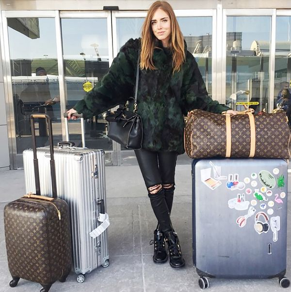 Chiara Ferragni carries Louis Vuitton and Rimowa.