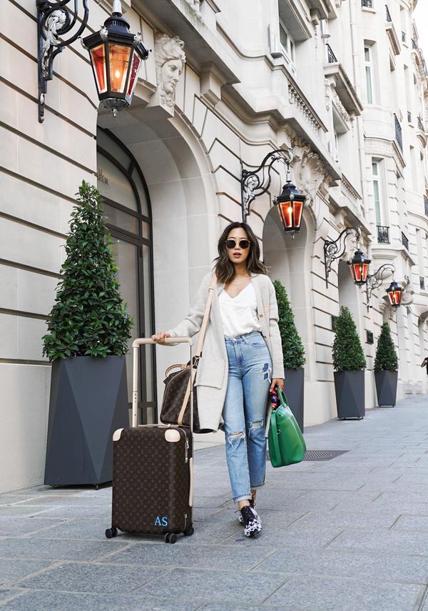 Aimee Song carries Louis Vuitton.