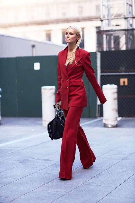 Red is the color of fall. Jump on the trend in a head-to-toe fiery pantsuit and matching accessories.