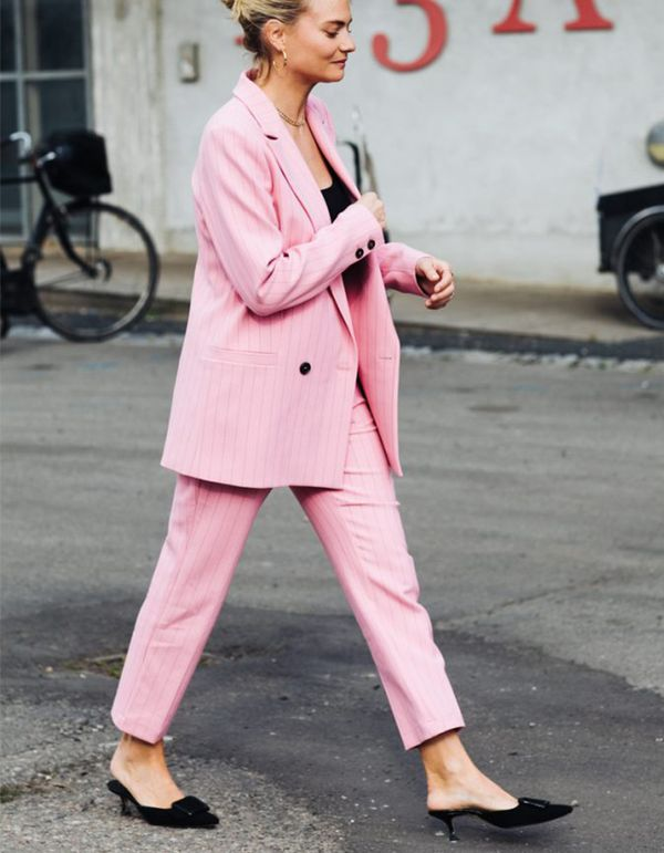 Give masculine tailoring a feminine spin in statement head-to-toe pink. Keep the rest of your look simple in neutral kitten heels and a relaxed tee, a far cry from stockbroker stuffy.