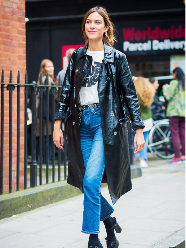 Alexa Chung wearing black vinyl trench coat at London Fashion Week