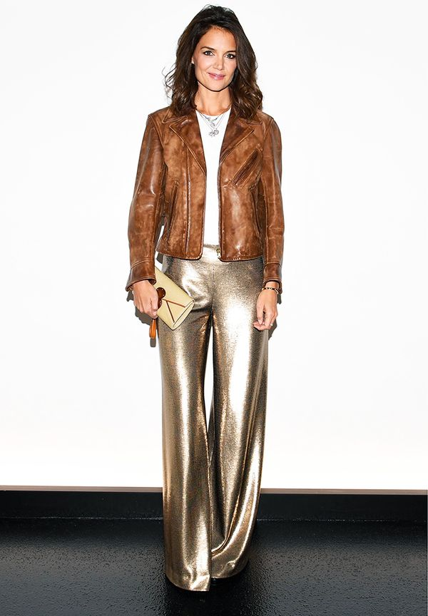 Katie Holmes Style: in gold trousers, a white tee, and a brown biker jacket