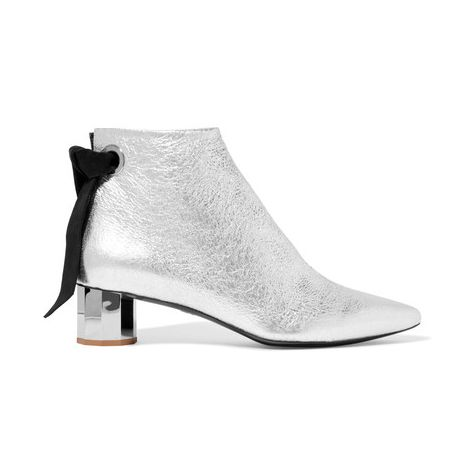 Proenza Schouler Suede-Trimmed Metallic Ankle Boots The chic suede ribbon isn't the only detail worth noticing—our favorite feature is the geometric heel.