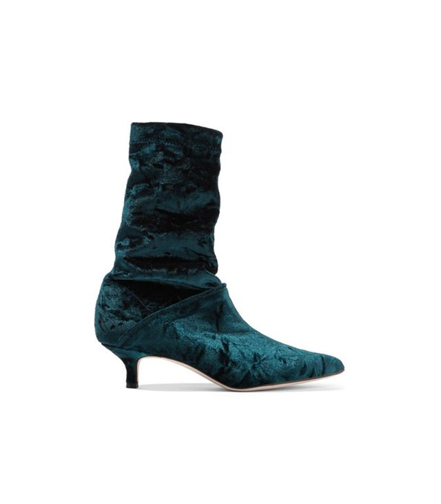 Tibi Harper Crushed-Velvet Boots Something's going on with Tibi at the moment—these teal velvet booties are just one of about 15 pairs of the brand's shoes we're coveting RN.