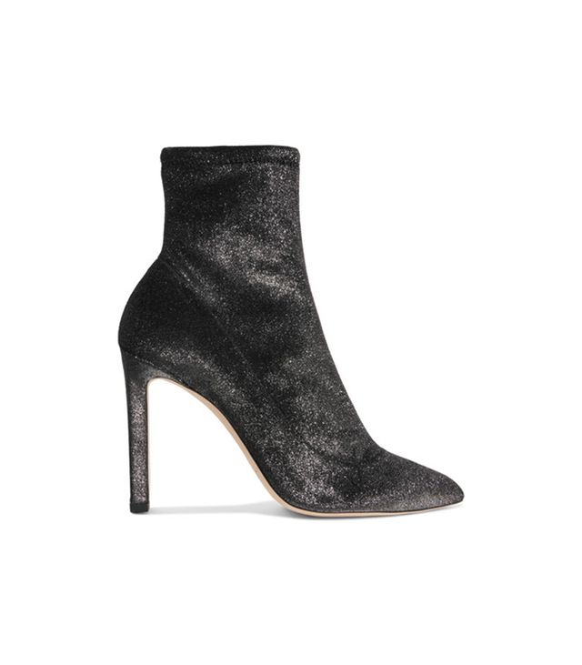 Jimmy ChooLouella 100 Metallic Stretch-Velvet Sock Boots These stretch-velvetbooties in shimmering gunmetal areperfect witha head-to-toe black look.