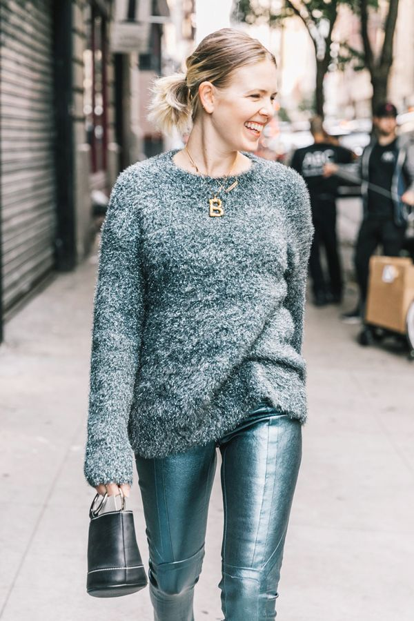 Day 29: Style your leather pants with a cozy fall sweater.