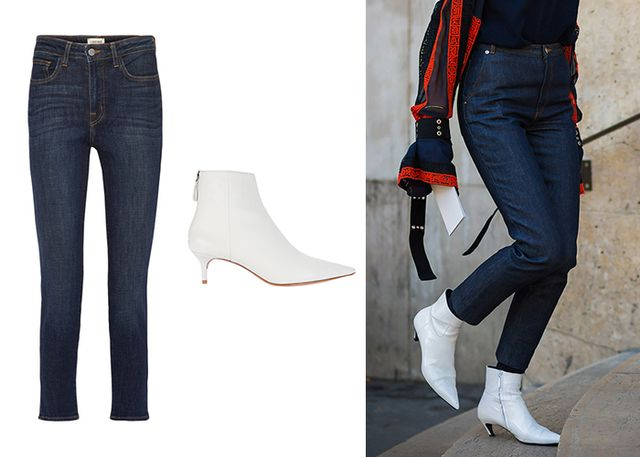 Slim-fitting, high-waisted navy jeans worn with this season's white ankle boots make for an incredibly chic and sophisticated pairing.