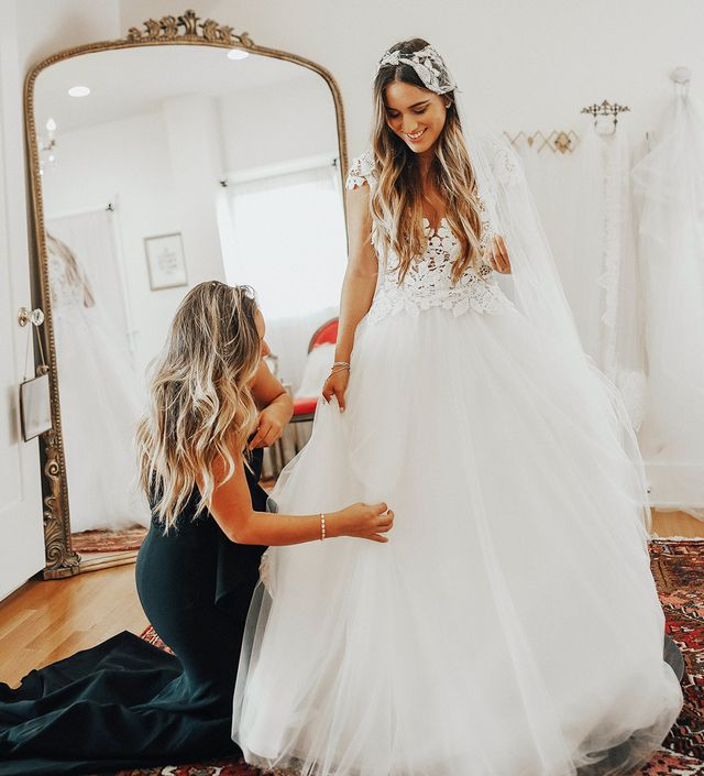 For her second look, Ybarra tried on a princess-style short-sleeve embroidered dress. This time she tested out a truly glamorous bohemian look complete with loose beach waves and a glitzy crown.
