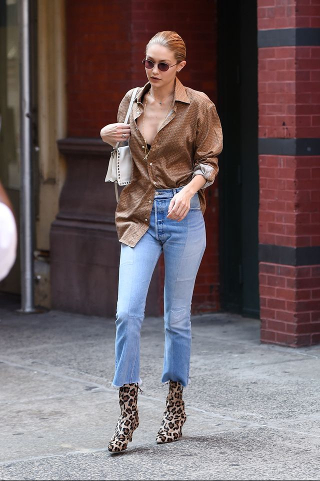 Gigi Hadid wearing jeans and boots