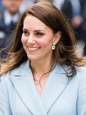 Kate Middleton Just Debuted Her Baby Bump in a Pretty Lace Dress