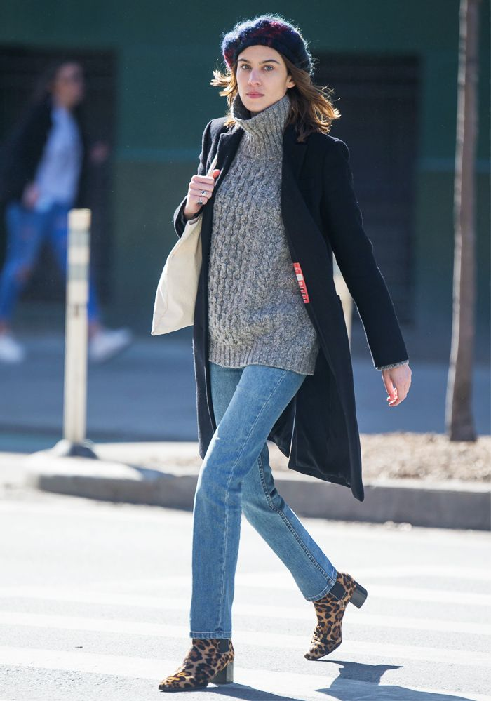 Alexa Chung wearing animal print Chelsea boots and jeans in New York