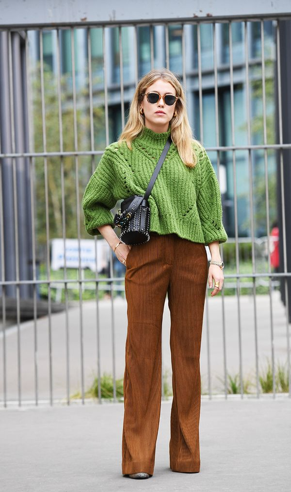 Give corduroy pants an elevated feel by wearing with a chunky-knit cropped sweater and edgy leather bag.