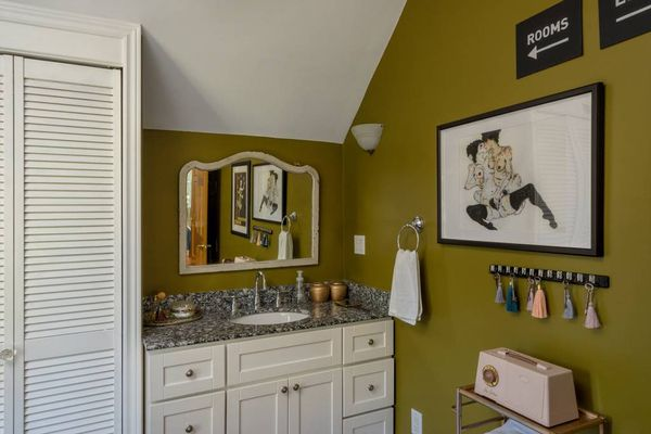 Even the bathroom boasts clever designs to reference Anderson's style.